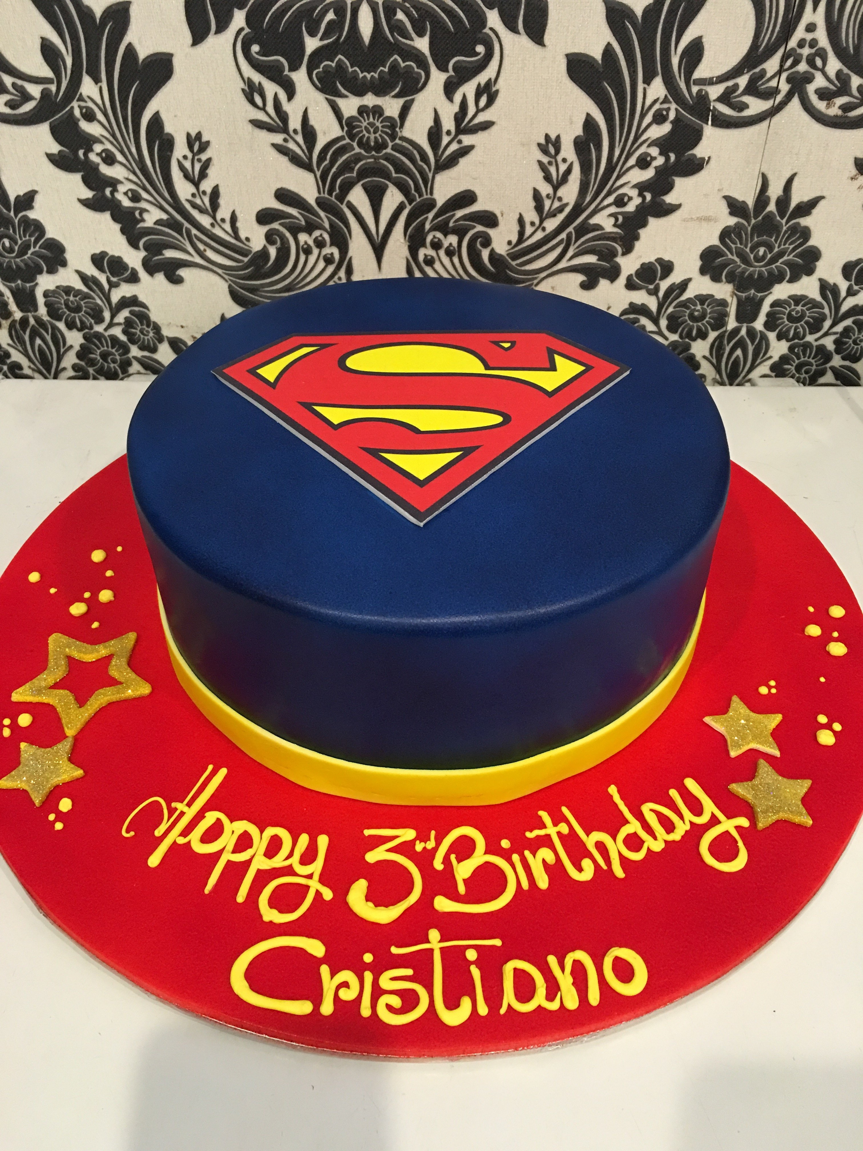 blue red and gold superman custom cake