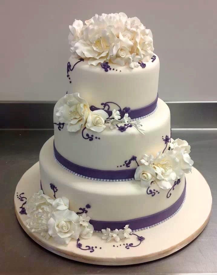 triple tier christening cake with bride groom