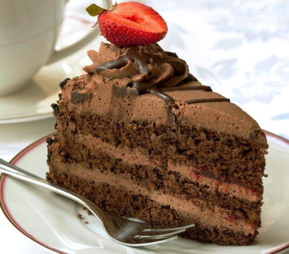 Delicious chocolate cake slice with strawberry half