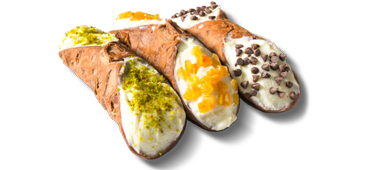 Three cannolis with different fillings