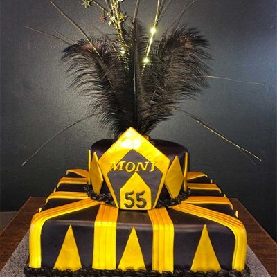 Gold and black great gatsby cake with feathers