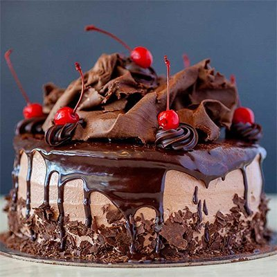 Chocolate torte with cherries and chocolate curls
