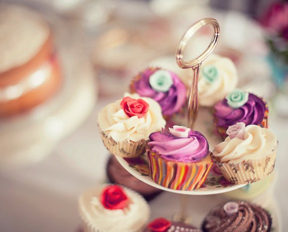 Cake stand filled with tasty iced cupcakes
