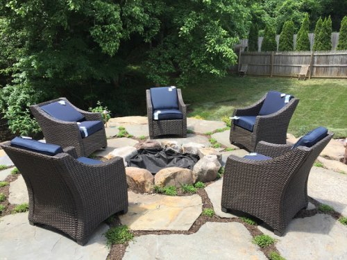 outdoor armchairs and patio fireplace