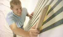 Expert performing wallpapering