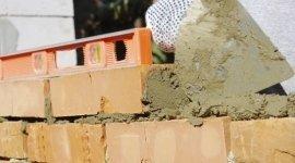 opere murarie, mattoni pieni, applicazione calcestruzzo