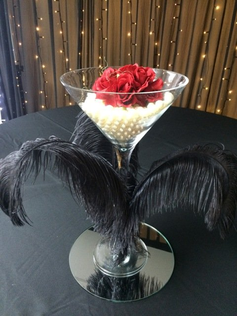 Giant martini glass ostrich feather centrepiece with pearls & roses