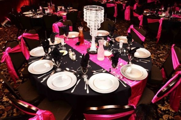 Black Tablecloth, black chair covers and pink table runner and chair sashes