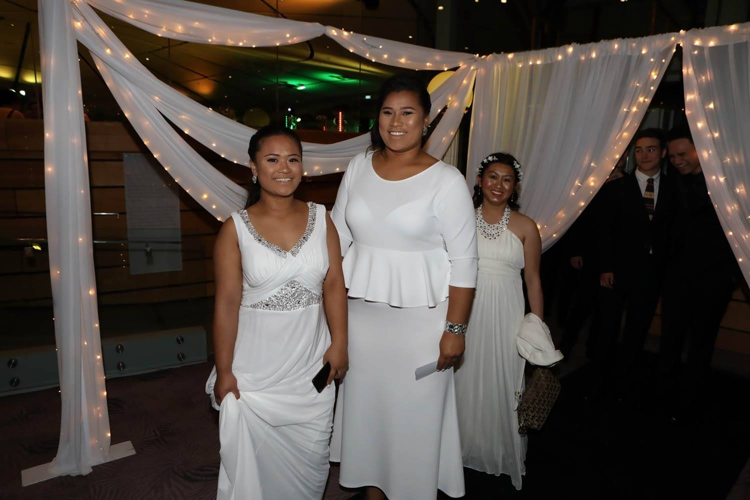 Women dressed in white at an event