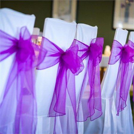 Purple Organza chair sash on white banquet chair covers