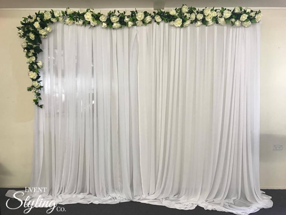 White chiffon draping with flower garland