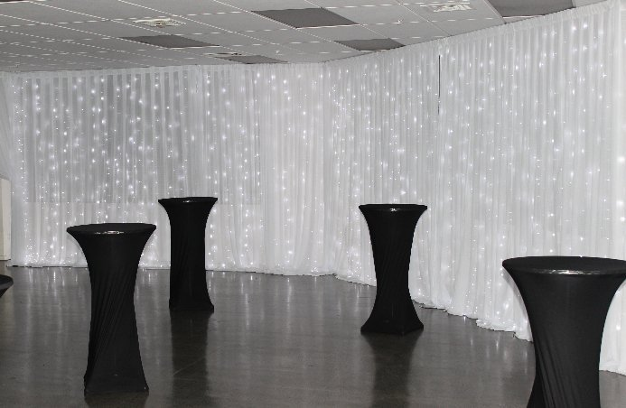 Pure white fairy light wall draping