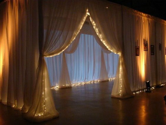 Draped entrance ways with fairy lights
