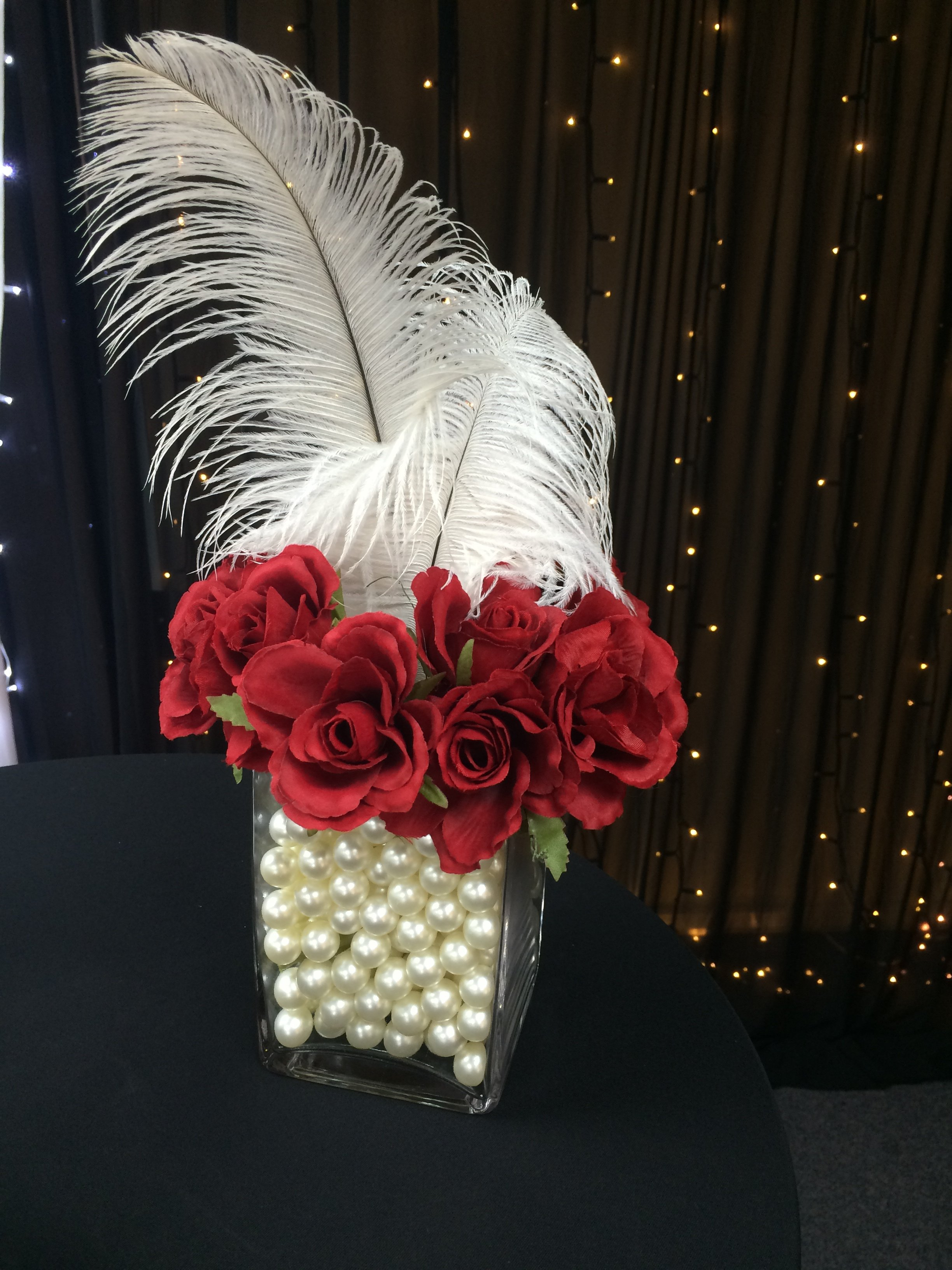 Pearl rose and feather cube centrepiece