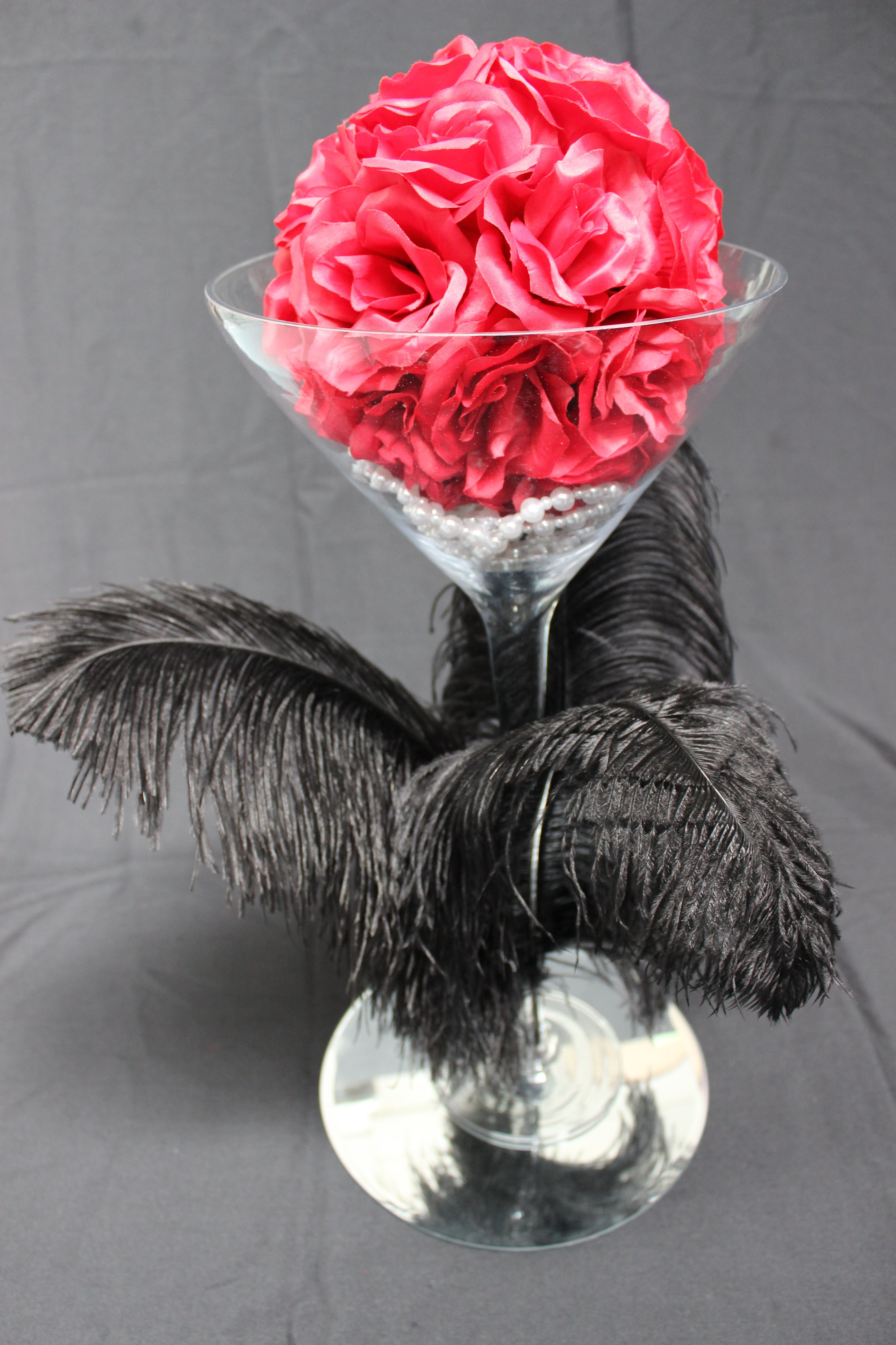Martini ostrich feather centrepiece with pearls and roseball on mirror $25 incl gst