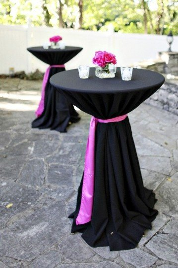 Bar leaner dressed in Black Table cloth with Pink sash
