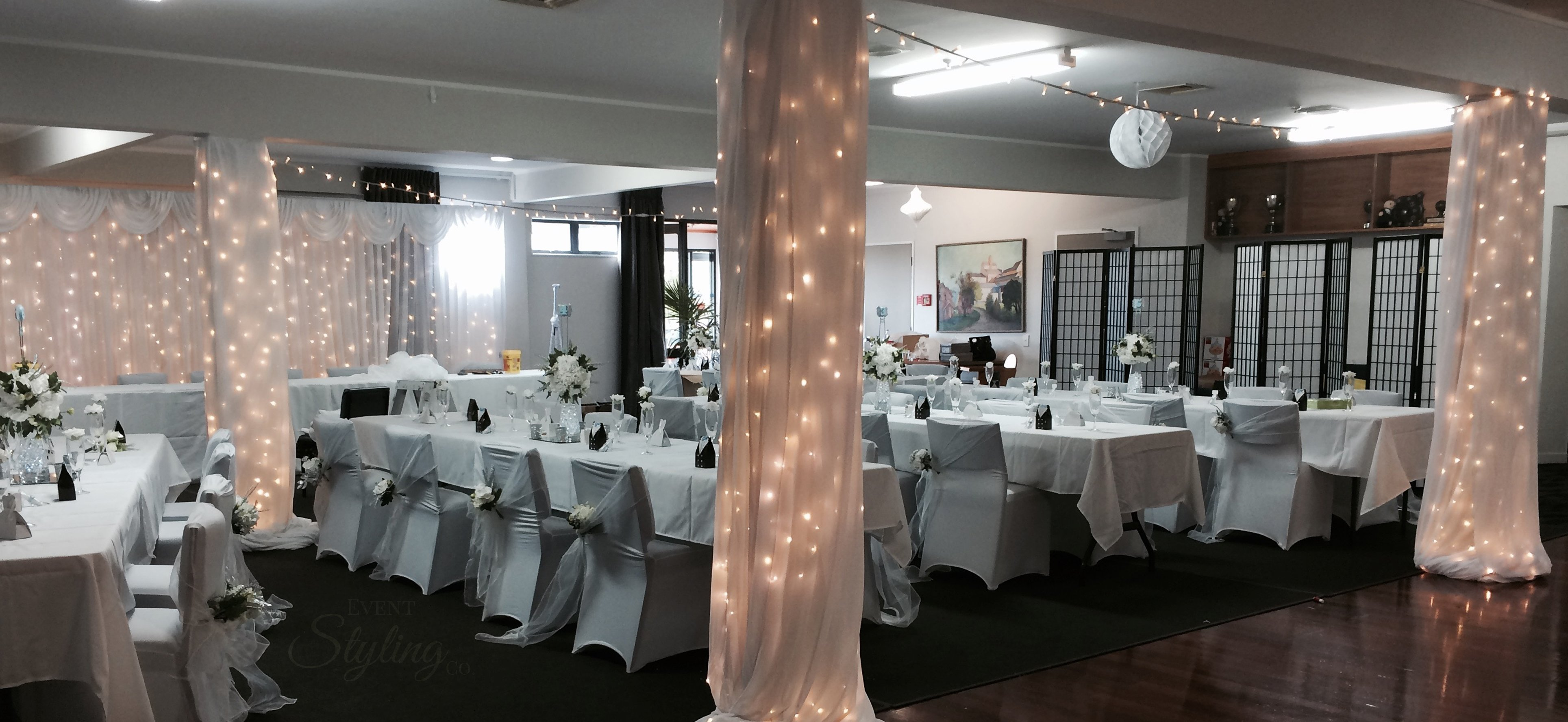 Lighting and sound event styling co auckland fairy light and fabric dressed pillars with white fairy curtain backdrop by event styling co for junglespirit Image collections