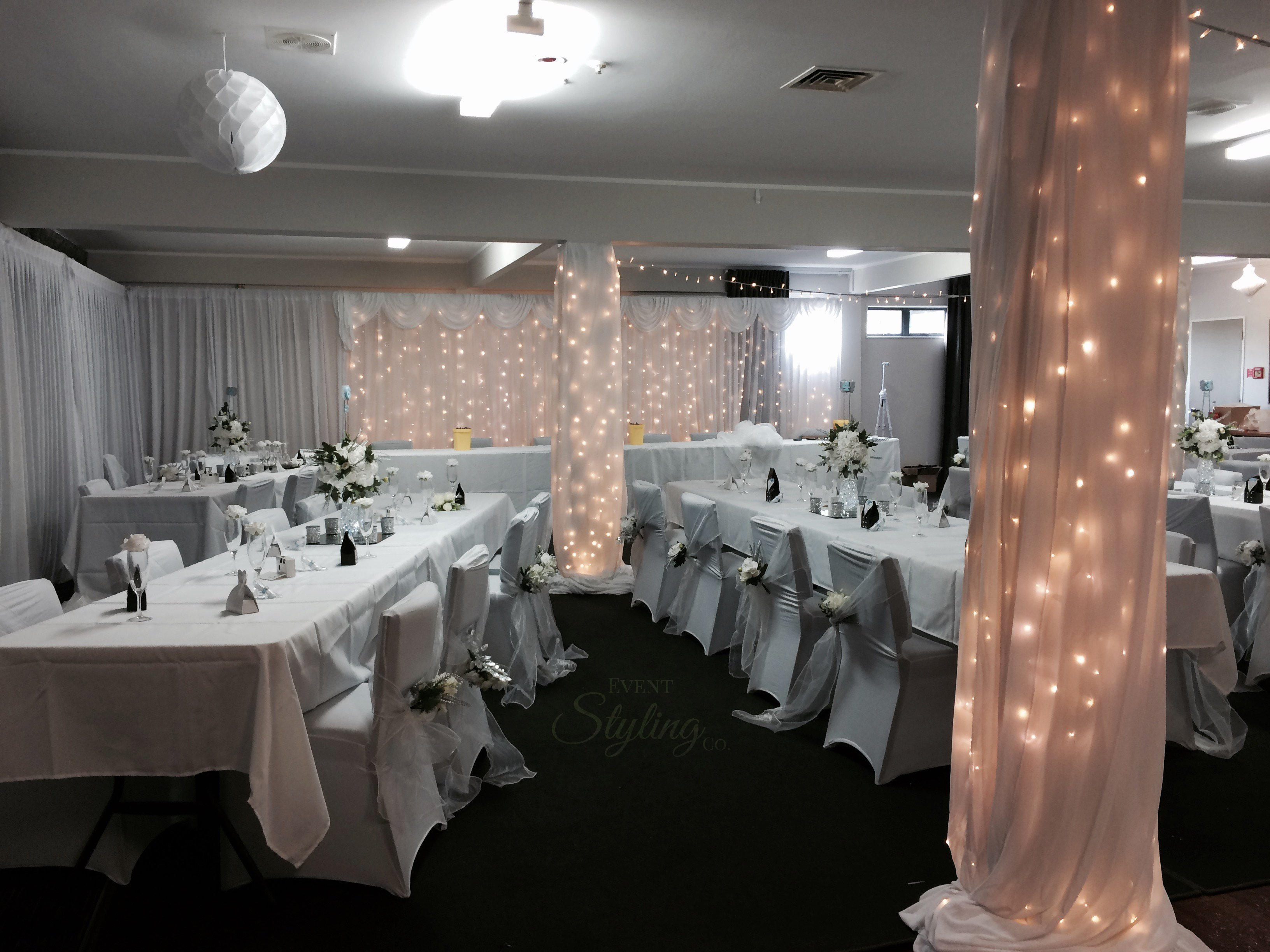 White fairy curtain and Pillar draping and fairy lighting
