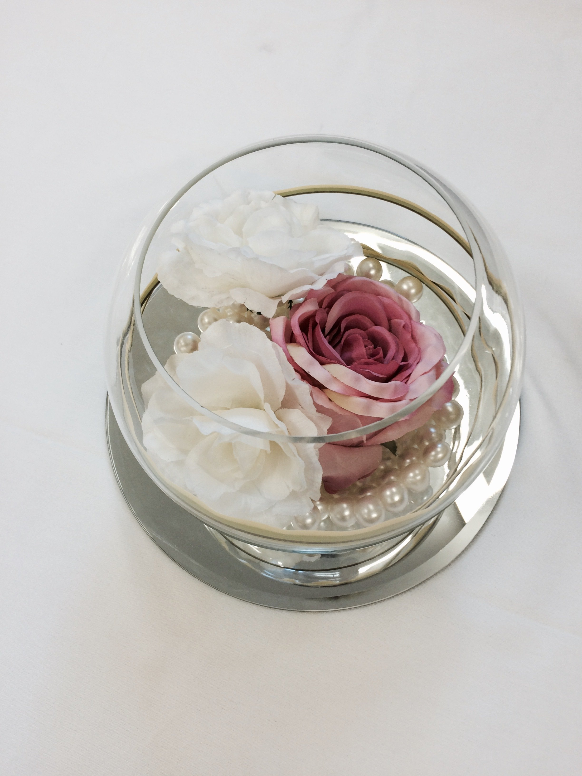 top view of a glass with roses