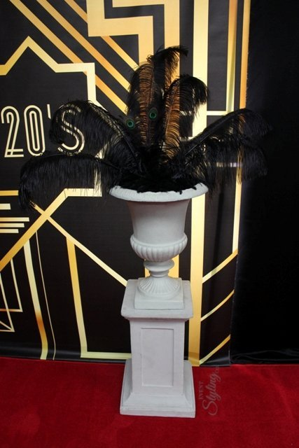 Urn with large ostrich feathers
