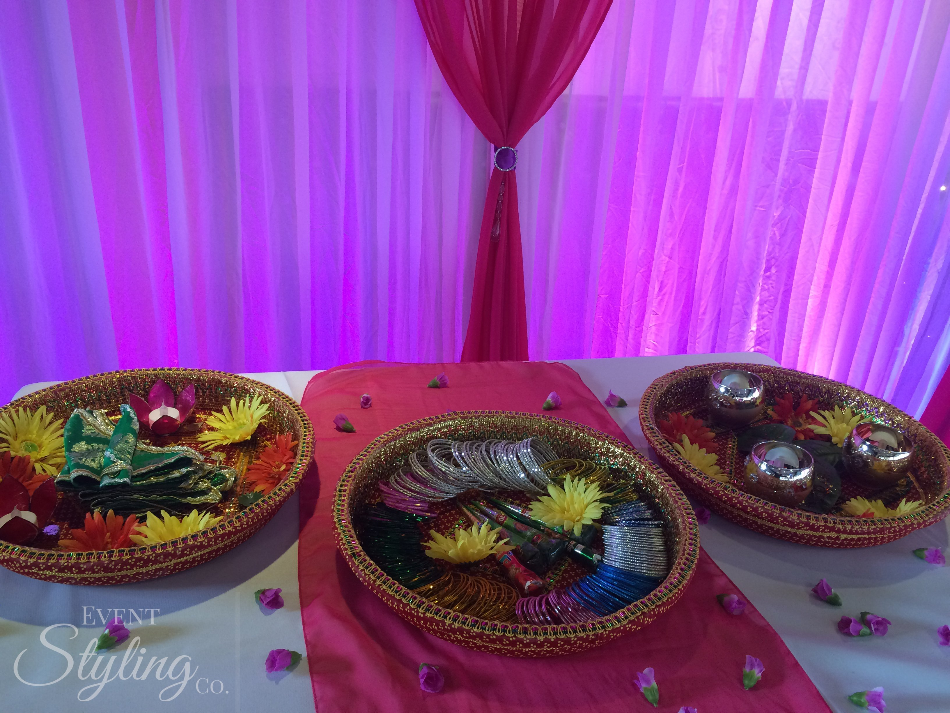 Bespoke pink wall draping and event lighting at Bollywood restaurant auckland for Mehendi night.