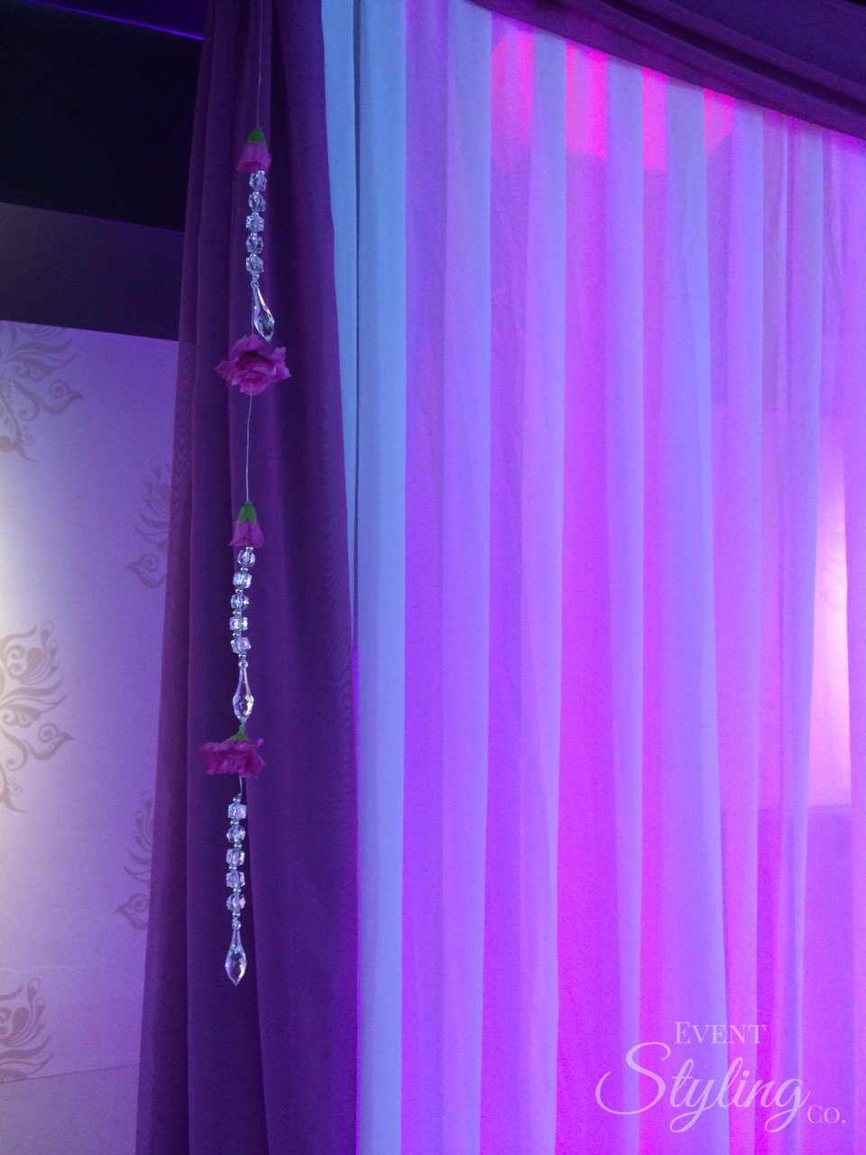 Bespoke purple wall drapes and event lighting at Bollywood restaurant Auckland