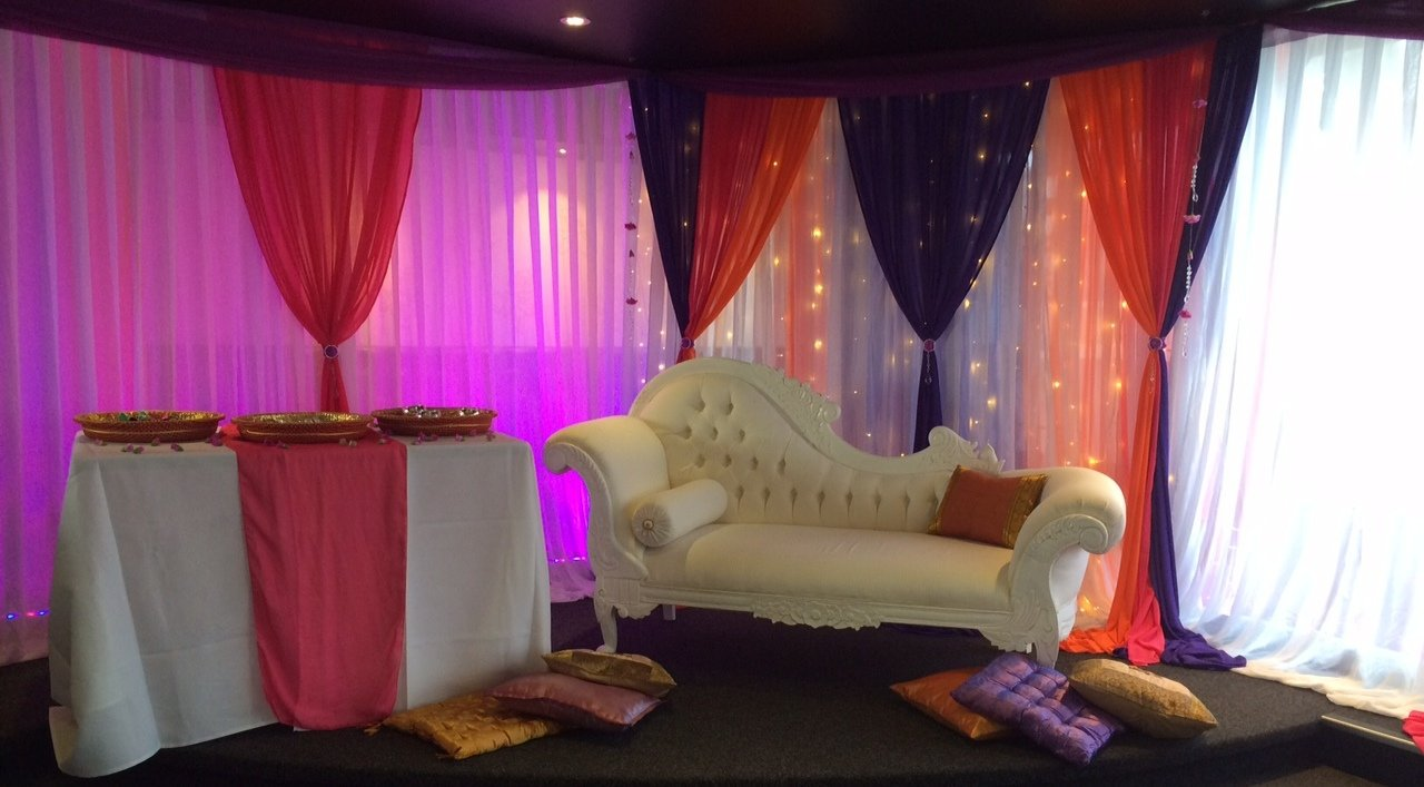 Bespoke fairy curtain with purple, pink and orange wall draping and coloured lighting for henna night at Bollywood restaurant Auckland