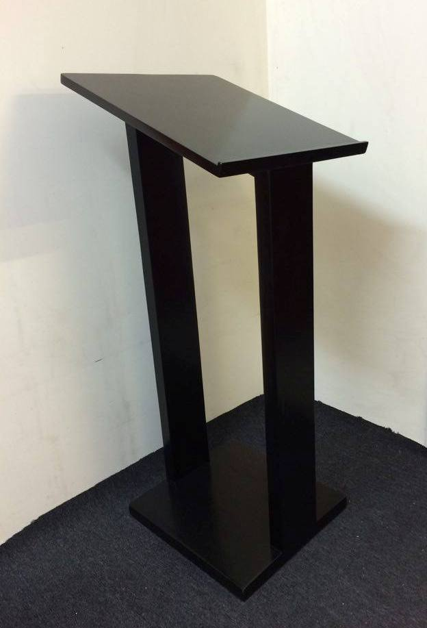 Lecturn also known as pulpit for reading speeches or music, Hardwood in black finish measurements Lecturn Black 1.2m H  x 460mm W x 500mm DHire Price $65 incl gst