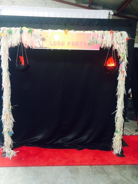 Luau Entrance with small hanging flame lights