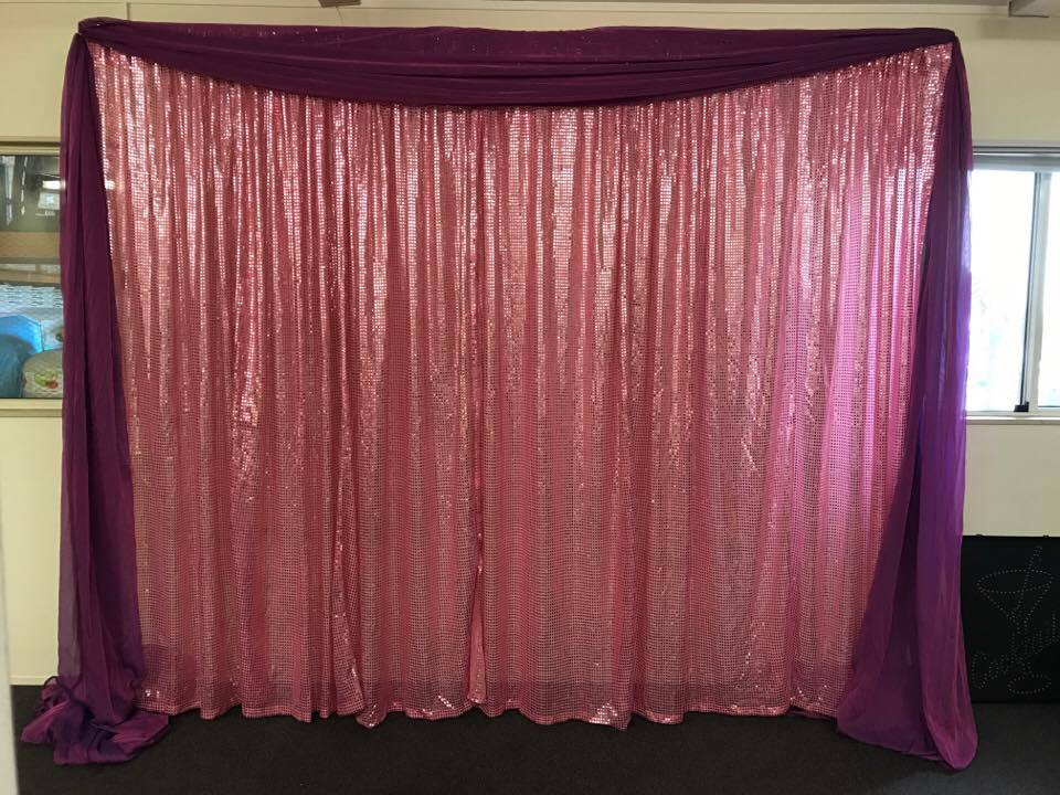 Pink sequin wall draping with purple swa