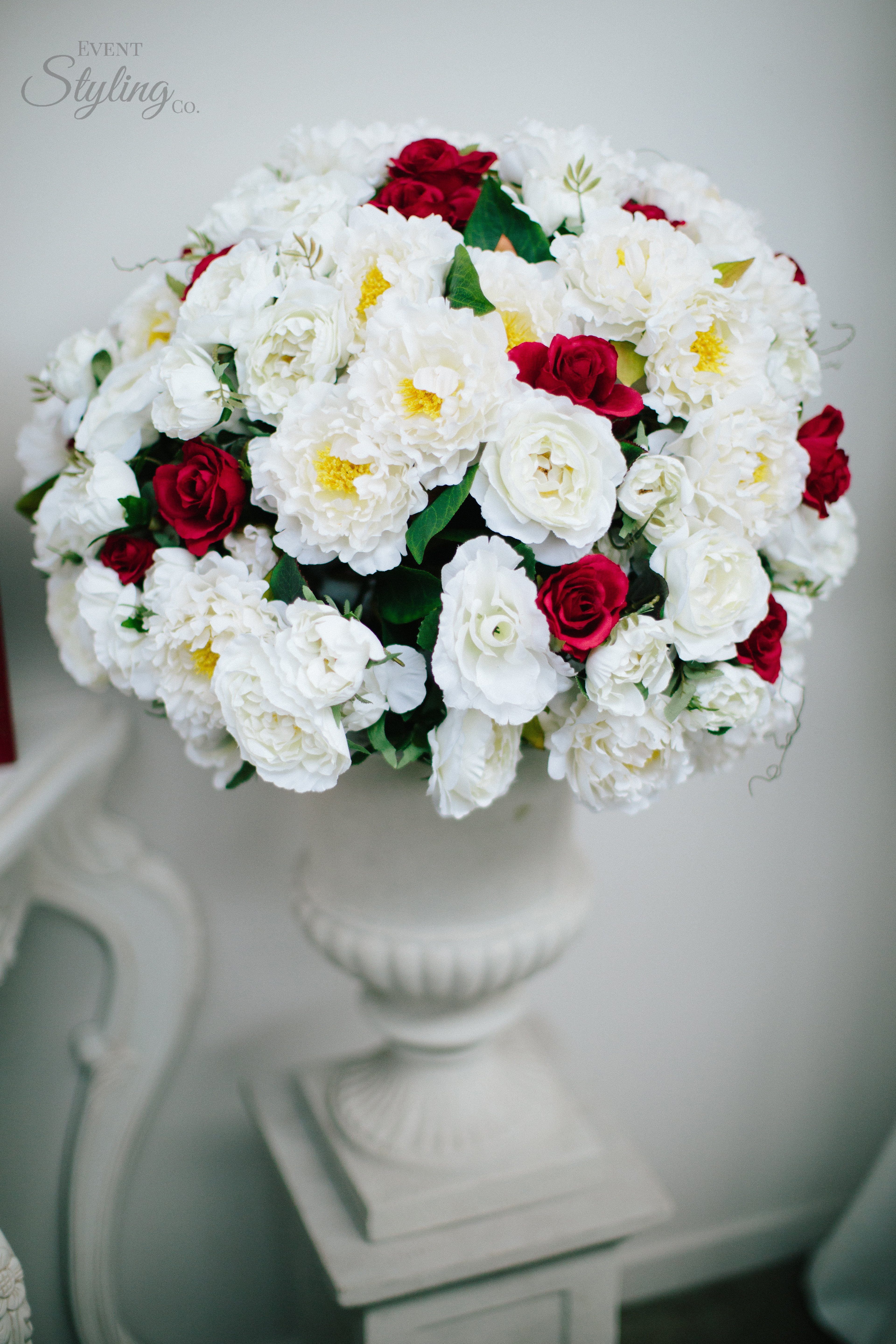 White wash urn with flowers