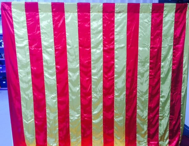 Wall Draping Circus red & yellow stripes 3m x 3mHire price $30 incl frame & gst