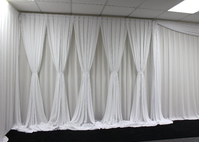 White Double draped backdrop