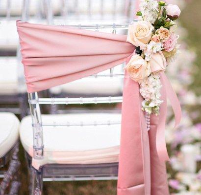 Pink satin sash on our clear chiavari chair