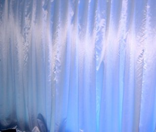 White satin wall draping 3m wide x 2.4m highHire price from $30 incl frame and gst