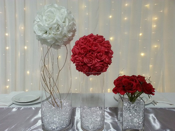 Centrepieces from left  to right , Tall gold branch $25, Med Red Flowerball $20 Cube Rose $12 incl