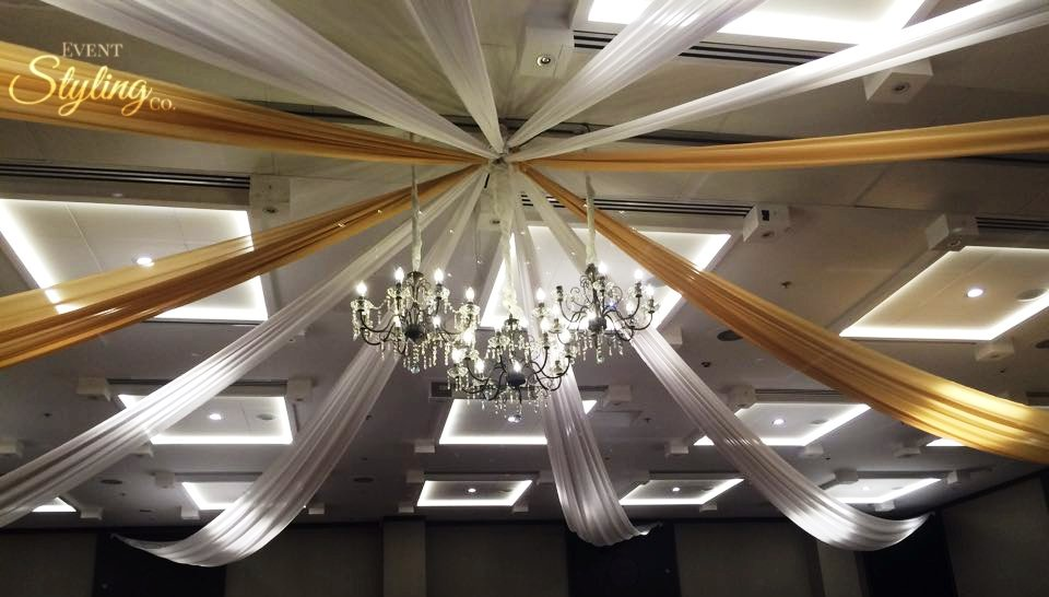3 vintage chandeliers with bronze and white ceiling draping at Crown Plaza hotel Auckland