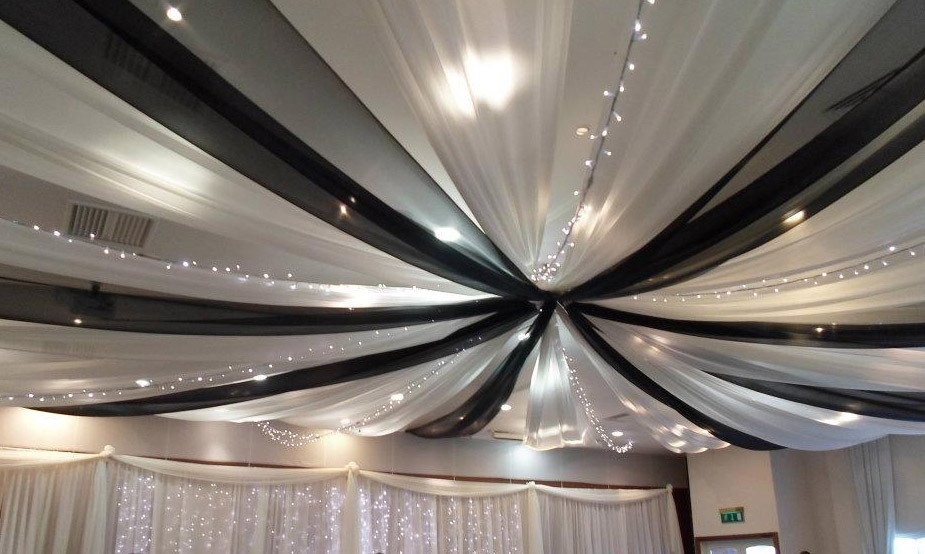 Black and white drapes with fairy lights