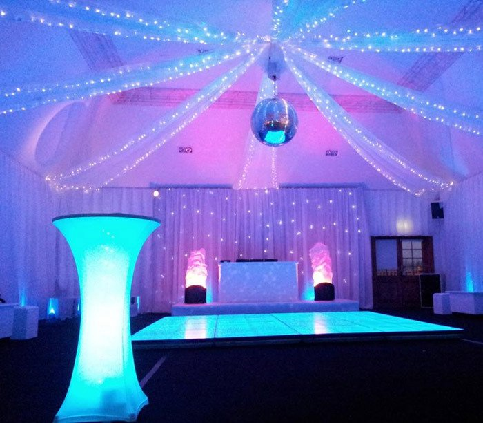 Ceiling draping with fairy lights and Mirror ball.