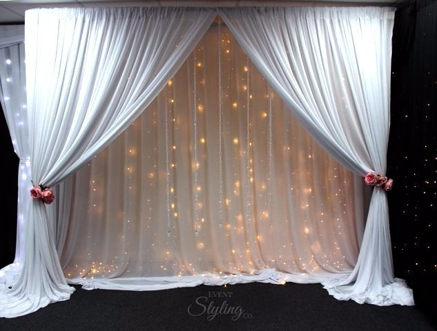 Bespoke Fairy curtain with draped front, crystal stands and pink roses.Hire price from $450 including Auckland installation