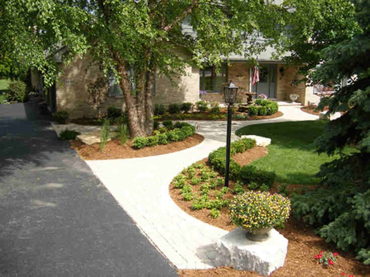 Curved Brick Walkway with Landscaped Garden Beds