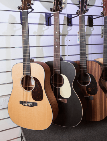 Acoustic guitars lined up
