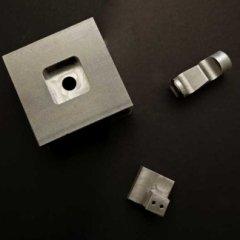 componenti in acciaio dopo fresatura