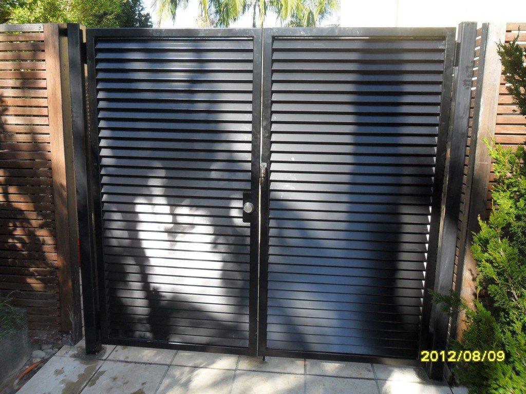 Large black custom aluminium palings