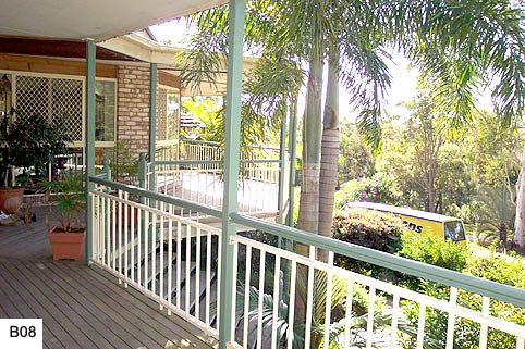 Green and white custom balustrades