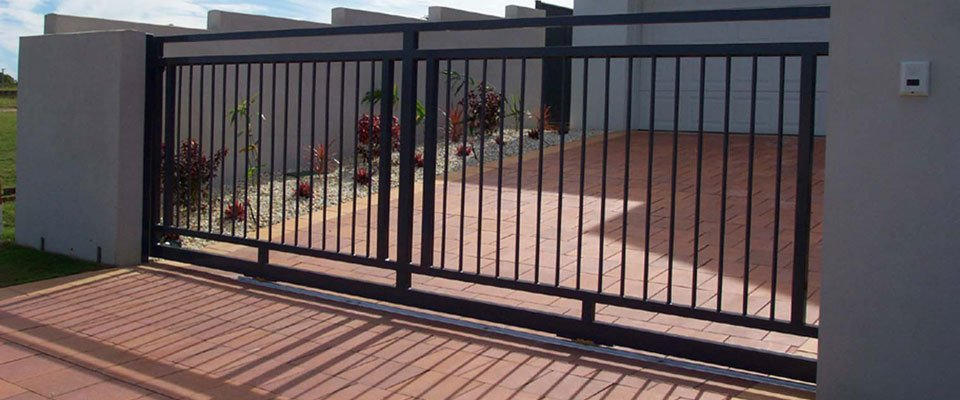 Black sliding gates for the customer residence