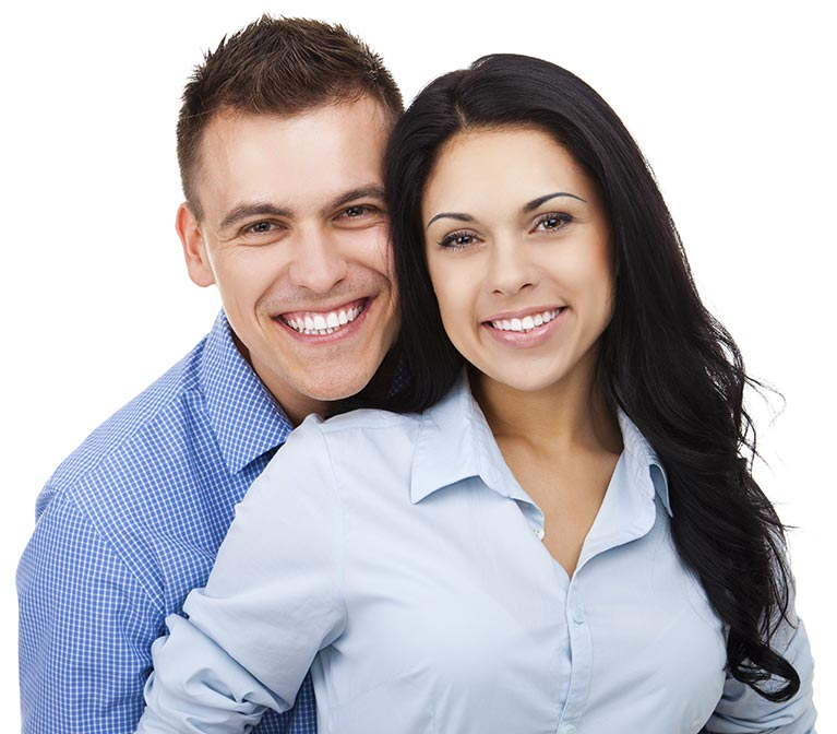 A couple with dental implants from our Sydney clinic