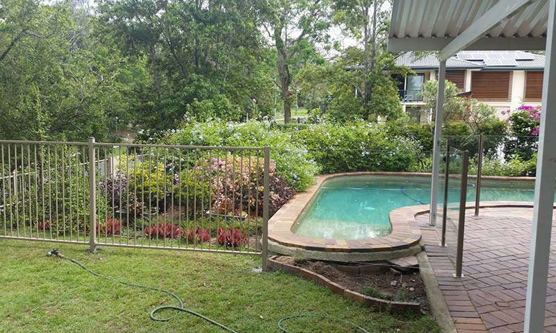 garden and pool with aluminium fencing