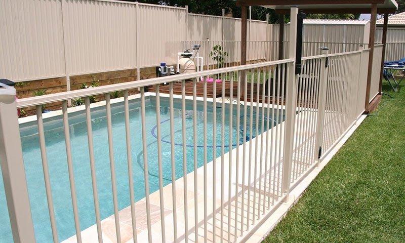 white backyard pool fences