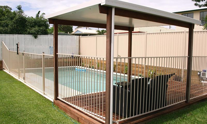 white fence around pool